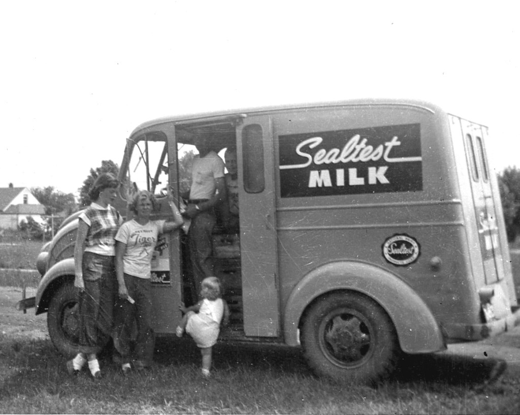 Divco Milktruck about 1950, dad at the wheel, me behind, two sisters and cousin outside.